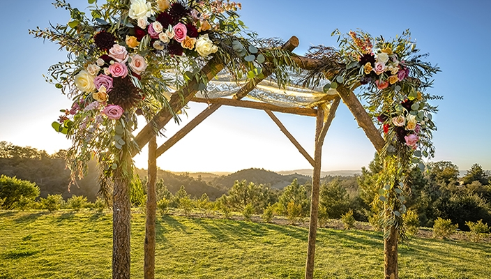 outdoor chuppah with roses